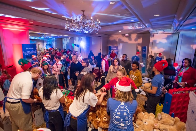 Families picked a bear and outfit from Build a Bear at Yellow Ribbons United Winter Wonderland.