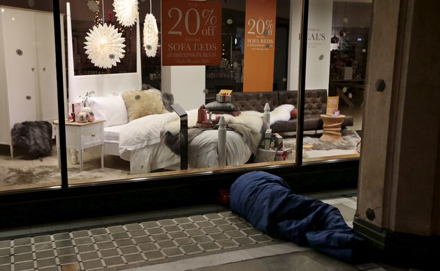 The number of homeless children in Britain is at a ten year high; a homeless man is pictured sleeping...