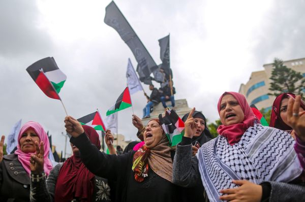 Palestinian women shout slogans during a protest in Gaza City on December 6, 2017.