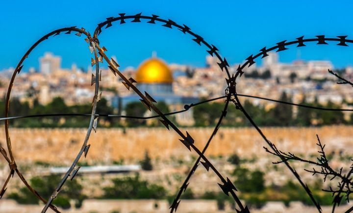 The Dome of the Rock in Jerusalem, as seen through barbed wire.
