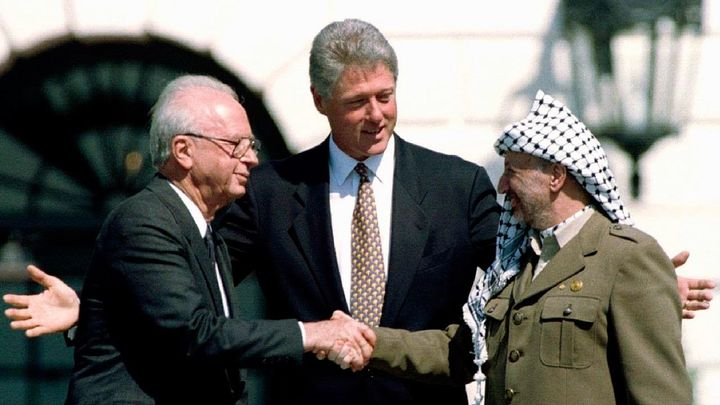President Clinton nudges two old enemies toward each other - Israeli Prime Minister Yitzhak Rabin and Chairman of the Palesti