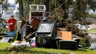 James Ronduen removes debirs from his stepdaughter's house in the aftermath of Tropical Storm Harvey in Orange, Texas, U.S. September 5, 2017. REUTERS/Jonathan Bachman