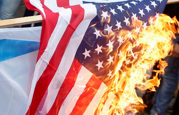 A US flag burns during the