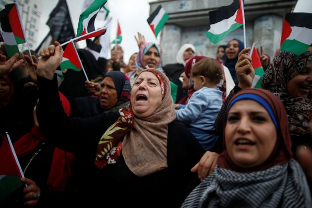 Palestinian women voice their anger during protests against Trump in Gaza