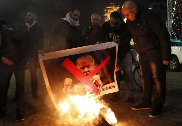 A picture of Trump is set alight in Bethlehem on December