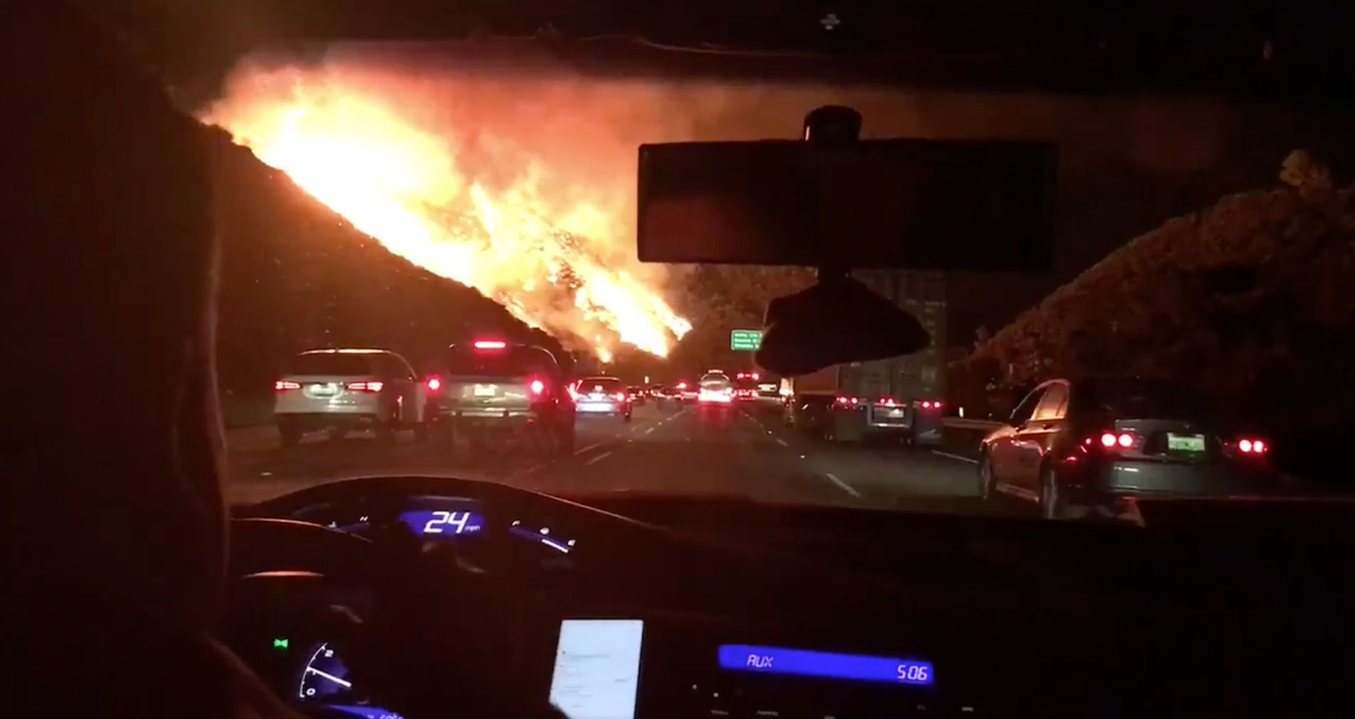 Flames are seen alongside the 405 freeway near the Getty Center in Los Angeles Wednesday morning