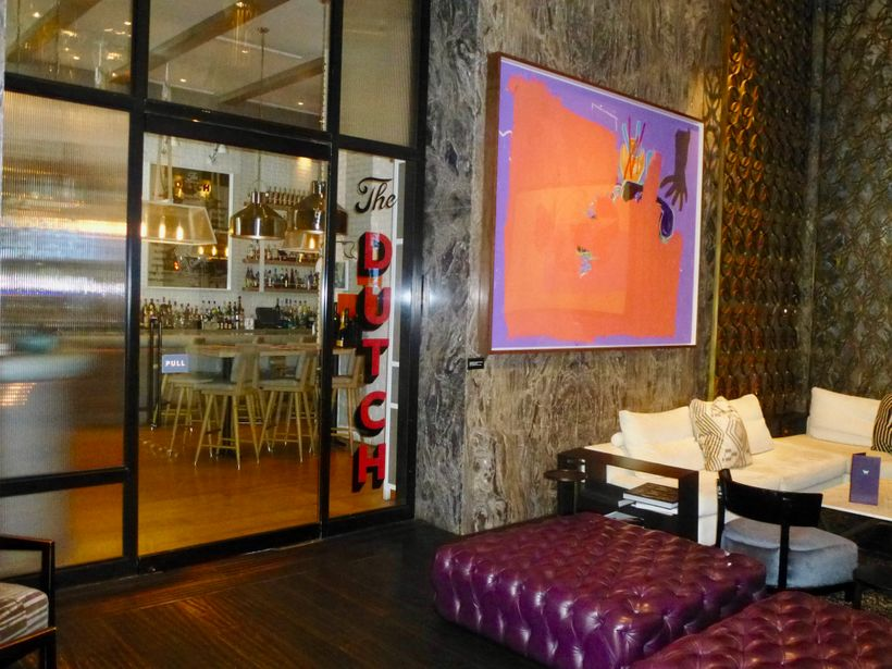 Works by Andy Warhol, Jean-Michel Basquiat and Salvador Dali are just outside The Dutch at the W, South Beach hotel.