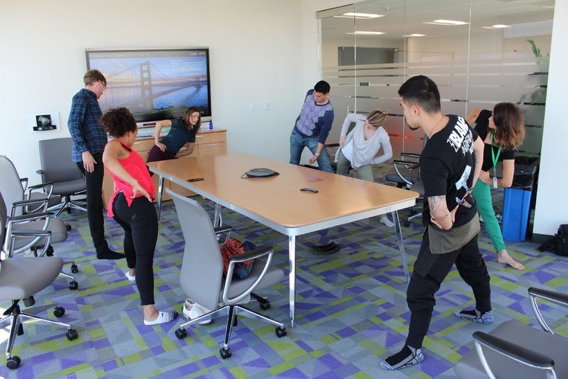<em>An effective office yoga teacher is able to adapt sequences for non-traditional yoga spaces. Photo courtesy of </em><a re
