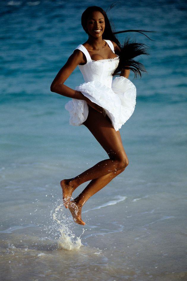 Naomi Campbell wears a dress designed by Azzedine