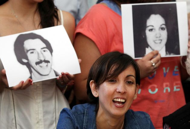Adriana flanked with pictures of her parentsVioleta Ortolani and Edgardo Garnier, who disappeared...