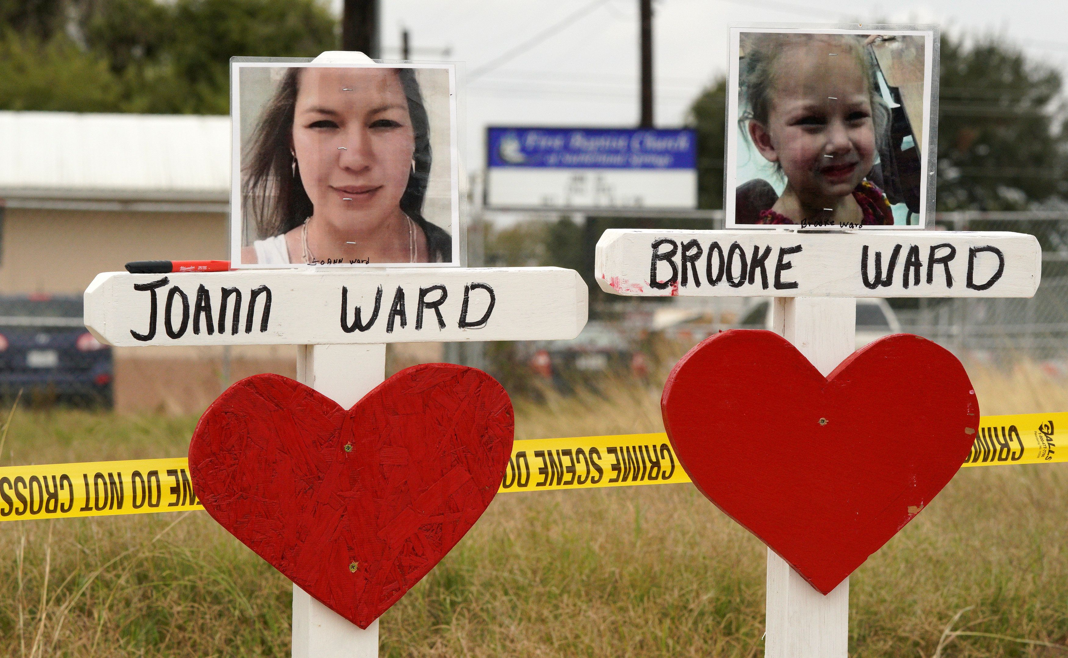 Crosses in remembrance of Joann Ward and Brooke Ward killed in the shooting at the First Baptist Church of Sutherland Springs, Texas, U.S., November 9, 2017.  REUTERS/Rick Wilking