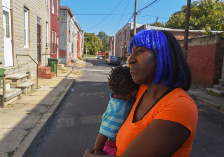 "<p>Darlene Summerville, holding daughter Ka-mia, and other residents call Lemmon Street ""the Forgetabout Neighborhood.""</p>"