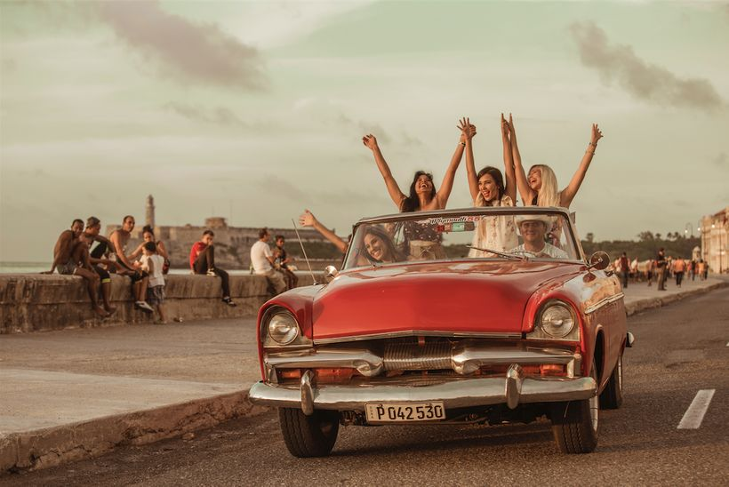 Havana Reverie clients enjoying themselves on the malecón.