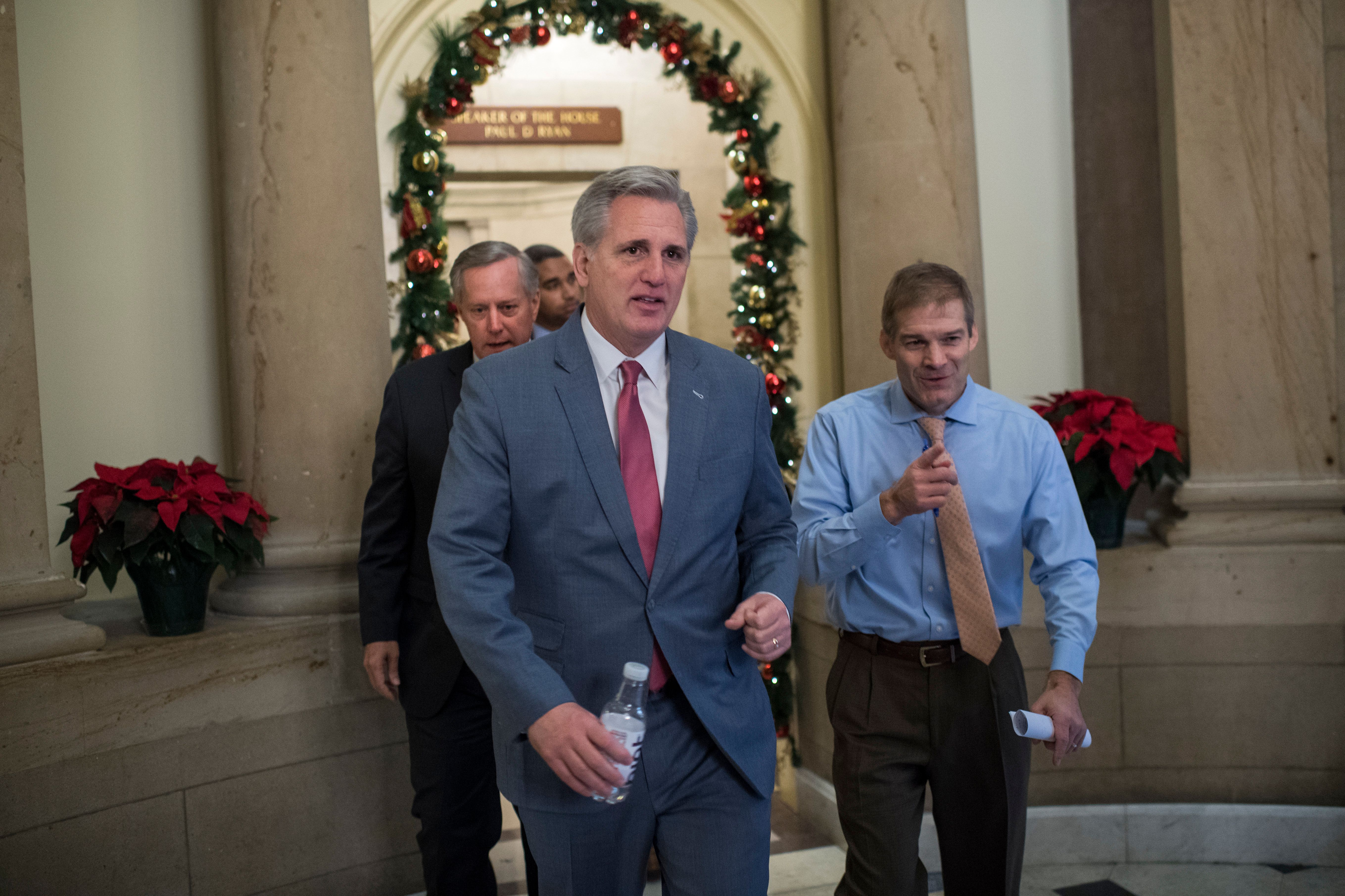 UNITED STATES - DECEMBER 06: From left, Rep. Mark Meadows, R-N.C., House Majority Leader Kevin McCarthy, R-Calif., and Rep. Jim Jordan, R-Ohio, leave a meeting in the Speaker's office in the Capitol on December 6, 2017. (Photo By Tom Williams/CQ Roll Call)