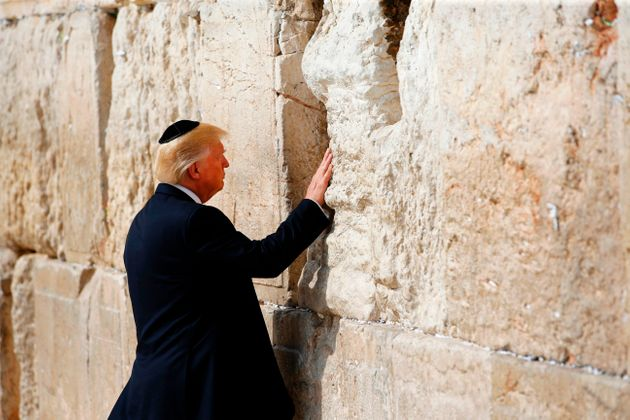 President Donald Trump visits the Western Wall, the holiest site where Jews can pray, in Jerusalem's...