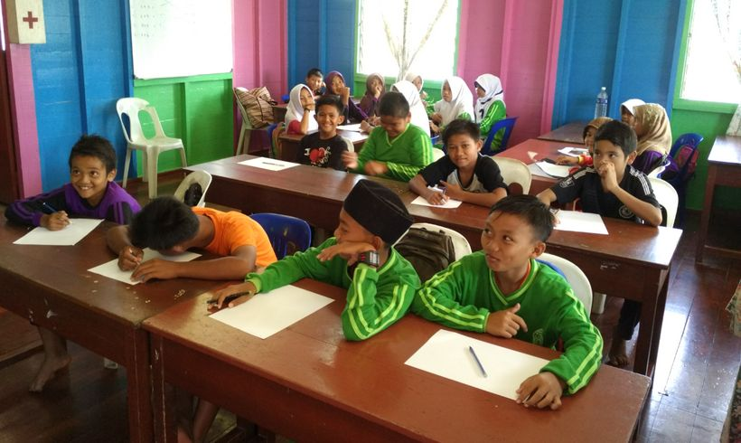 Plantation workers children at an estate operated school at Sarawak Oil Palms