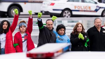 UNITED STATES - DECEMBER 6: Immigration protesters, including Rep. Luis Gutierrez, D-Ill., center, stand in a line after being arrested for staging a protest on the steps of the Capitol on Wednesday, Dec. 6, 2017. The protest was held to call on Congress to find a legislative fix for the legal status of people brought into the country illegally as children. (Photo By Bill Clark/CQ Roll Call)