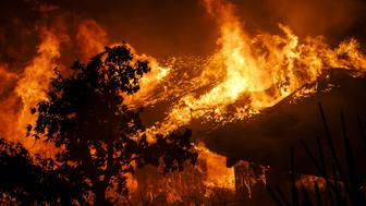 OAKVIEW, CA - DECEMBER 5: Flames engulf a home as brush fire sweeps through the area threatening structures on December 5, 2017 in Oakview, California. (Photo by Marcus Yam/Los Angeles Times via Getty Images)