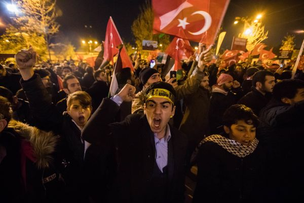 Protestors brandish Turkish flags during a protest against the Israel at Fatih Mosque in Istanbul, Turkey, 06 December 2017.&