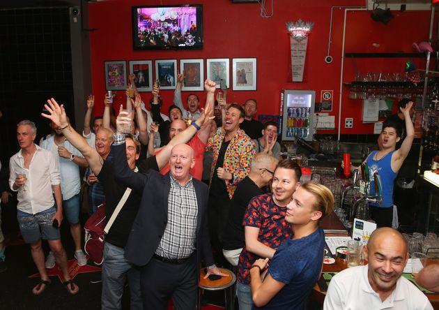 Patrons inside the Stonewall Hotel applaud the passing of the Gay Marriage Bill on December 7, 2017 in