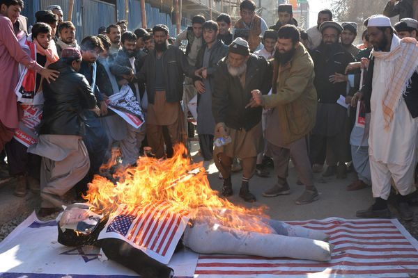 Protesters burn an effigy depecting Trump during a protest in Quetta, Pakistan on December 7, 2017.