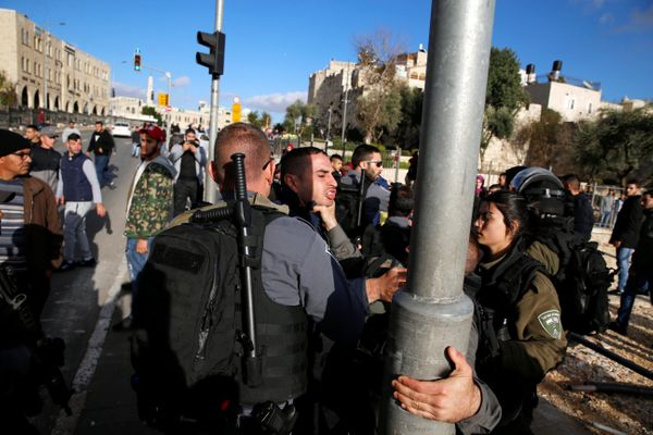 A Palestinian man scuffles with an Israeli border policeman during a protest near Damascus Gate in Jerusalem's Old City Decem