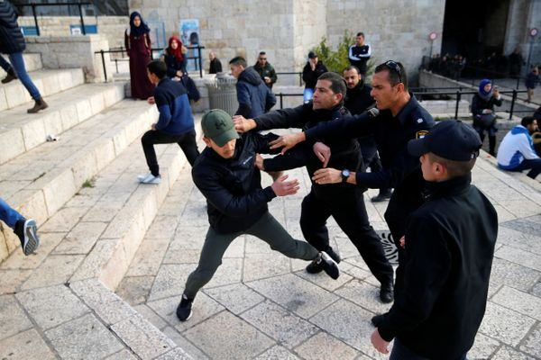Israeli policemen scuffle with a Palestinian man during a protest near Damascus Gate in Jerusalem's Old City December 7, 2017