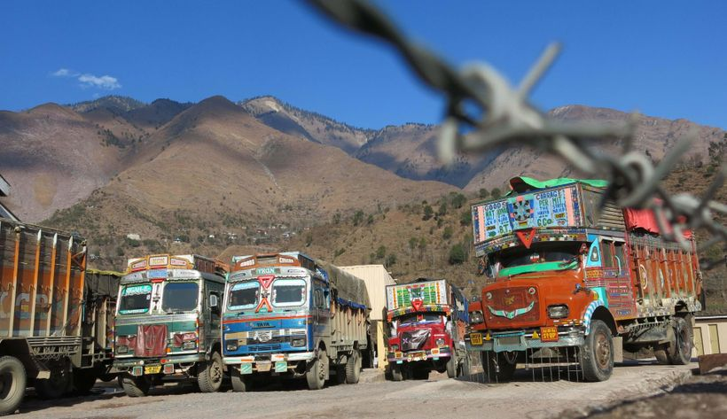 <strong><em>Trading trucks wait to cross the Line of Control in Chakothi, Pakistan-administered Kashmir</em></strong>