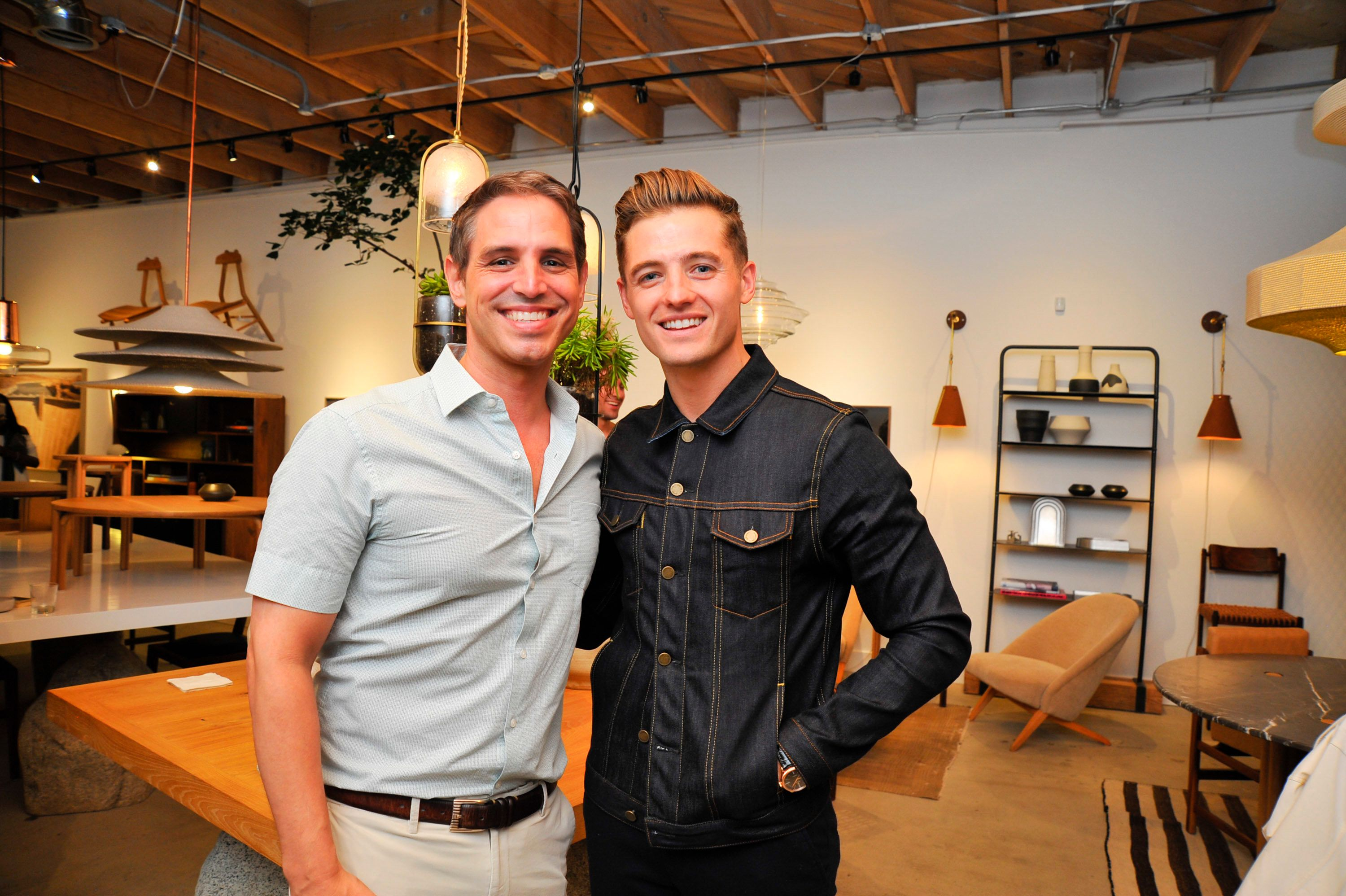 VENICE, CA - JULY 23:  Film writer Greg Berlanti and husband Professional soccer player Robbie Rogers attends Hampton + Baker Trunk Show and Fall Preview at Stahl and Band on July 23, 2016 in Venice, California.  (Photo by Lily Lawrence/Getty Images for Hampton + Baker)