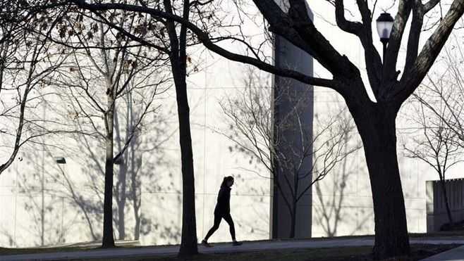 A lone student walks on the campus of the Massachusetts College of Liberal Arts in North Adams. Some states are giving foster