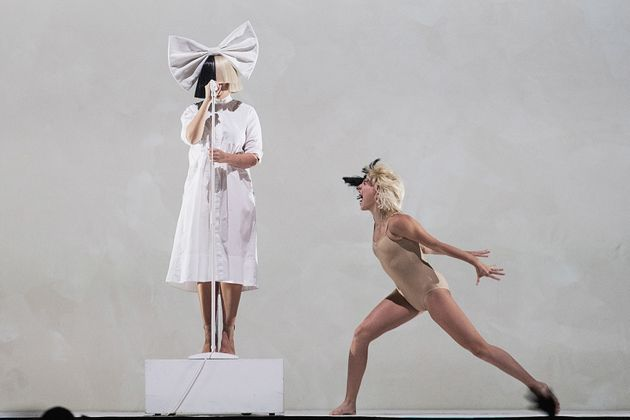 Sia and Maddie Ziegler perform on stage during the opening night of her 'Nostalgic for the Present' tour...