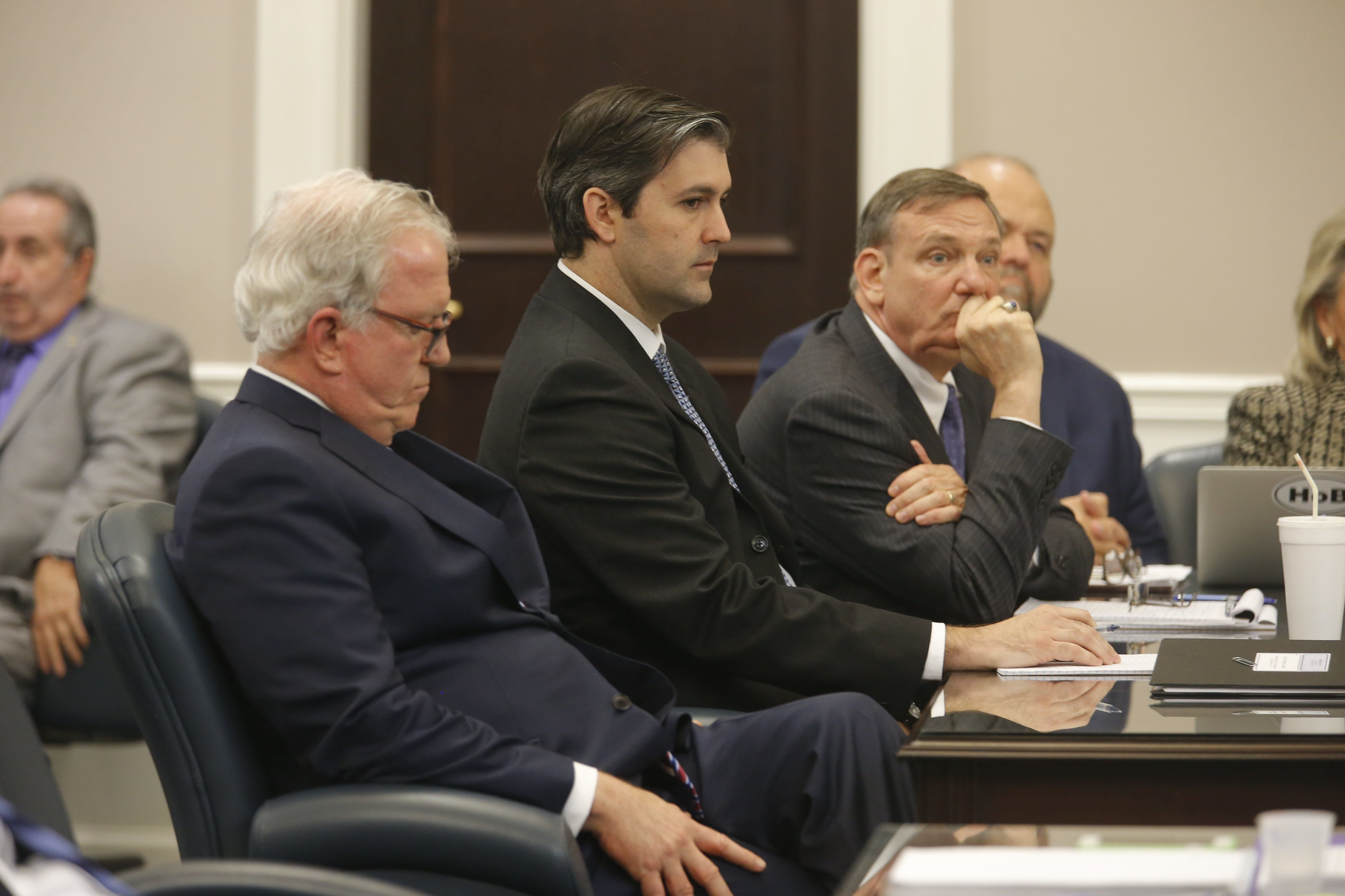 CHARLESTON, SC - DECEMBER 05: Defense attorneys Andy Savage, left, and Don McCune sit around former North Charleston police officer Michael Slager at theCharleston County court in Charleston, S.C., December 5, 2016. Judge Clifton Newman declared a mistrial after the jury was unable to reach a verdict. Slager was accused of shooting and killing Walter Scott, an unarmed black man during a traffic stop in April 2015. (Photo by Grace Beahm - Pool/Getty Images)