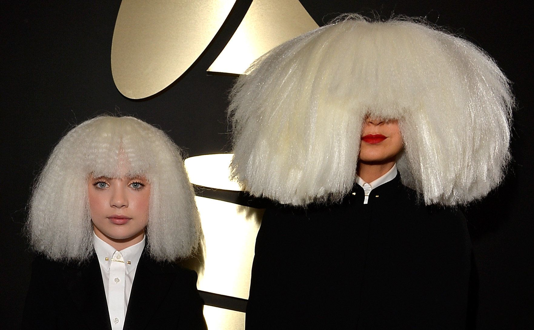 LOS ANGELES, CA - FEBRUARY 08:  Dancer Maddie Ziegler (L) and singer/songwriter Sia attend The 57th Annual GRAMMY Awards at the STAPLES Center on February 8, 2015 in Los Angeles, California.  (Photo by Lester Cohen/WireImage)