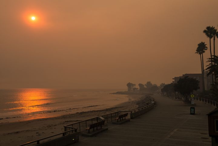The beach next to the Ventura Pier is seen surrounded by smoke on Wednesday.