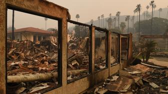 A wall stands in the burnt out Vista del Mar Hospital after the Thomas wildfire swept through Ventura, California on December 6, 2017. California motorists commuted past a blazing inferno Wednesday as wind-whipped wildfires raged across the Los Angeles region, with flames  triggering the closure of a major freeway and mandatory evacuations in an area dotted with mansions. / AFP PHOTO / Mark RALSTON        (Photo credit should read MARK RALSTON/AFP/Getty Images)
