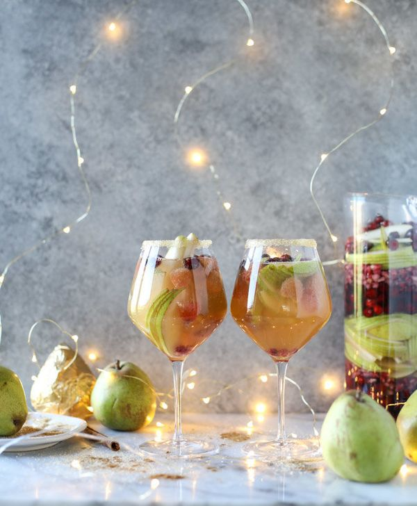 """<strong>Get the <a href=""""https://www.howsweeteats.com/2016/12/pear-sangria-video/"""" target=""""_blank"""">Pear Sangria</a> recipe fr"""