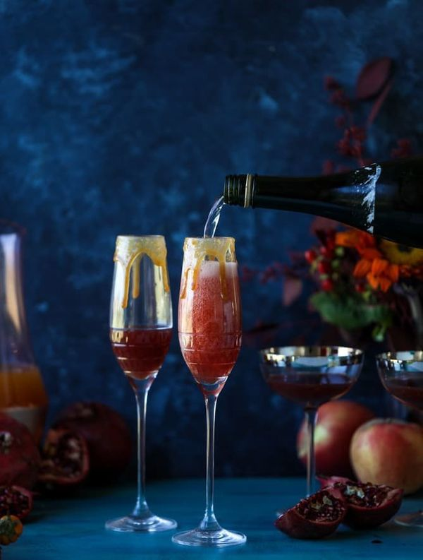 """<strong>Get the <a href=""""https://www.howsweeteats.com/2017/10/cider-mimosas-apple-pomegranate/"""" target=""""_blank"""">Pomegranate C"""