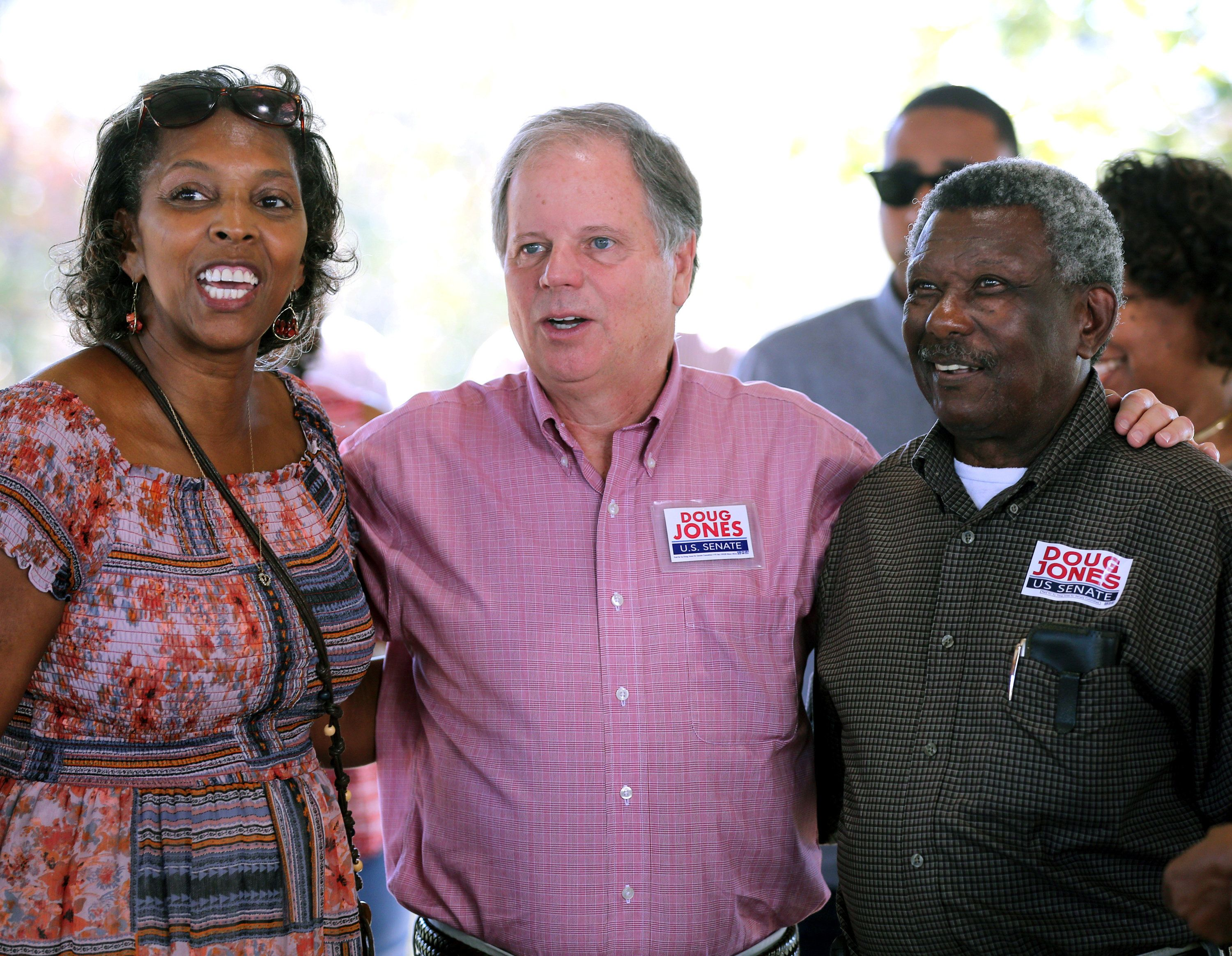 Democratic Alabama U.S. Senate candidate Doug Jones (L) greets supporters while campaigning at an outdoor festival in Grove Hill, Alabama, U.S. on November 4, 2017. Picture taken on November 4, 2017.   REUTERS/Mike Kittrell