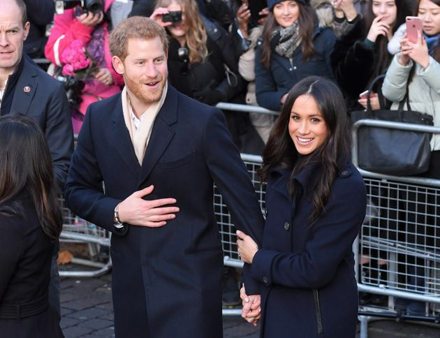 The newly engaged couple greet members of the British public in Nottingham, England, on Dec. 1,