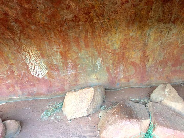 <p><strong>Ancient Rock Art At Uluru</strong></p>