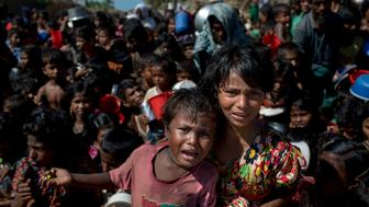 UKHIYA, COX'S BAZAR, BANGLADESH - 2017/11/14: Rohingya refugee childrens wait in front of a food distribution center at Thankhali Rohingya refugee camp in Ukhia district, Coxsbazar Bangladesh on. More than 615,000 Rohingya refugees have fled from Myanmar Rakhine state violence since from 25 August 2017, most trying to cross the border and reach Bangladesh. (Photo by K M Asad/LightRocket via Getty Images)