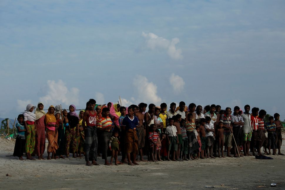 Rohingya refugees wait to cross the border into Bangladesh on Nov. 12, 2017.