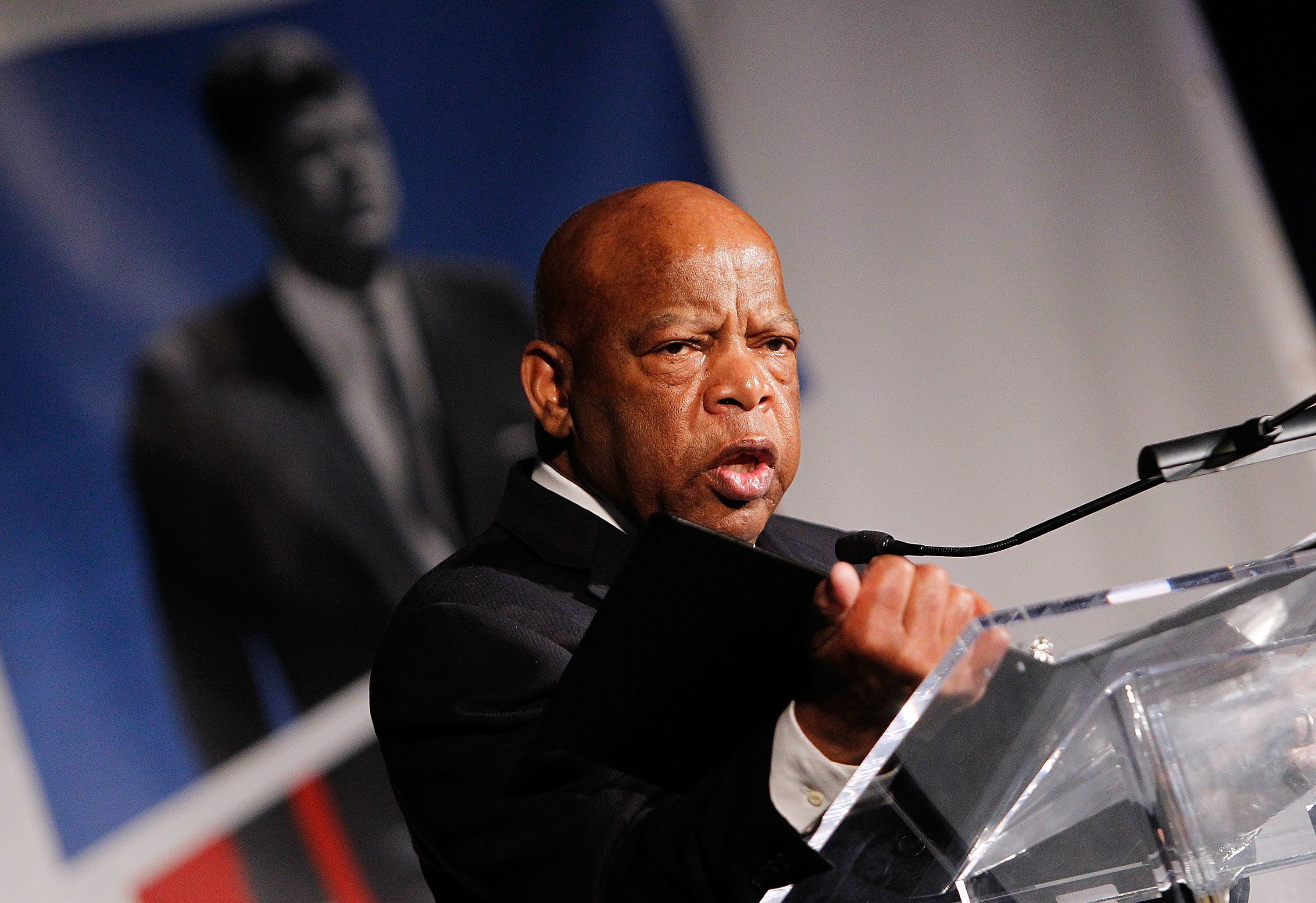 Rep. John Lewis (D-Ga.) speaking at an event in Washington, D.C., in May. He announced on Thursday that he will not attend th