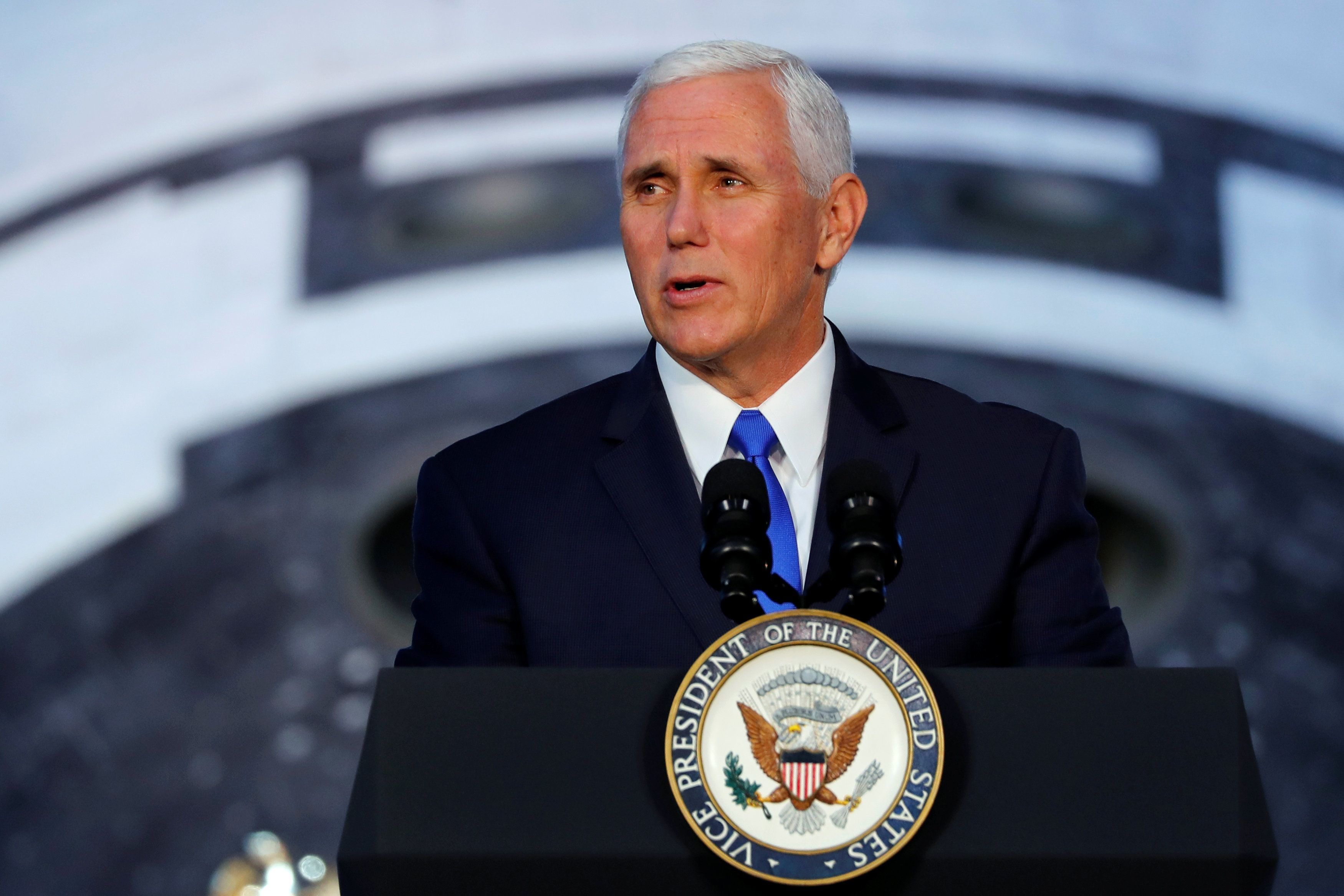 In the shadow of the Space Shuttle Discovery, U.S. ?Vice President Mike Pence? delivers remarks before convening the first meeting of National Space Council at the National Air and Space Museum's Udvar-Hazy Center in Chantilly, Virginia, U.S., October 5, 2017.  REUTERS/Jonathan Ernst
