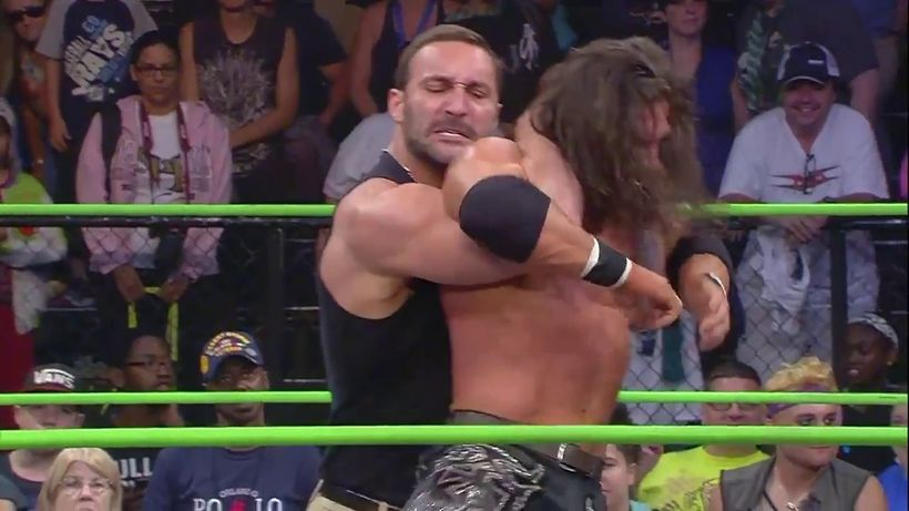"Chris Adonis applies the ""Adonis Lock"" on <em>Impact Wrestling</em> No. 1 contender Johnny Impact."