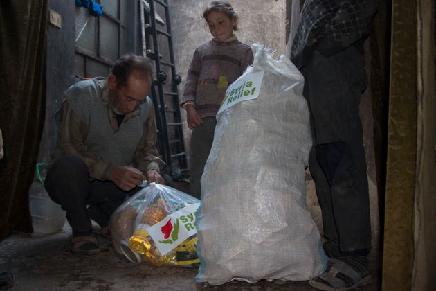 A family in Eastern Ghouta receiving a food