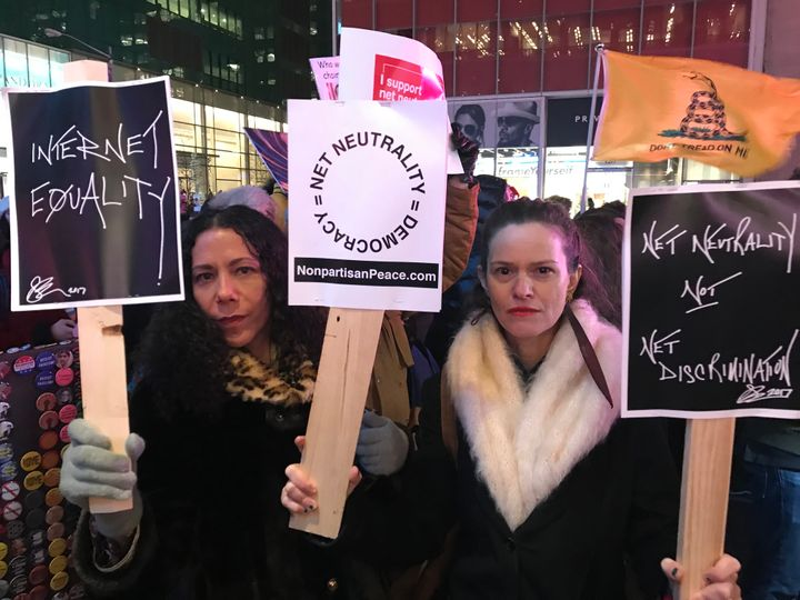 Net neutrality supporters Jennifer Elster (right) and friend gather at a rally in front of a Verizon store on 42nd Street in