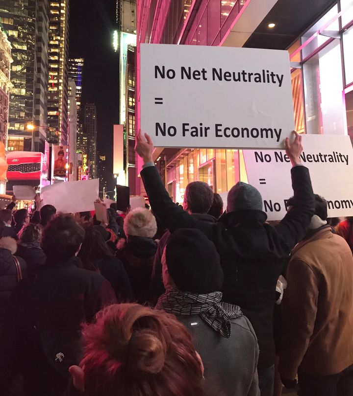 Net neutrality supporters gather at a rally in front of a Verizon store on 42nd Street in New York City on Dec. 7.