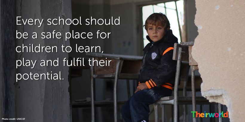 Ahmed, 6, sits in his damaged school, in Idlib, north Syria.