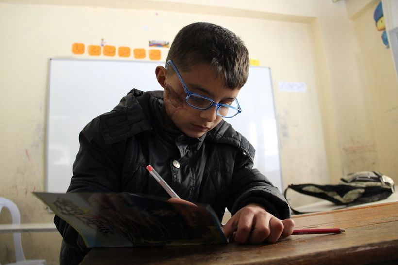 <strong>Nine-year-old Safi still bears the scars of a bombing attack on his school in Antakya, Syria</strong>